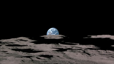 Earthrise at the Moon's south polar horizon, with Shackleton Crater in the foreground
