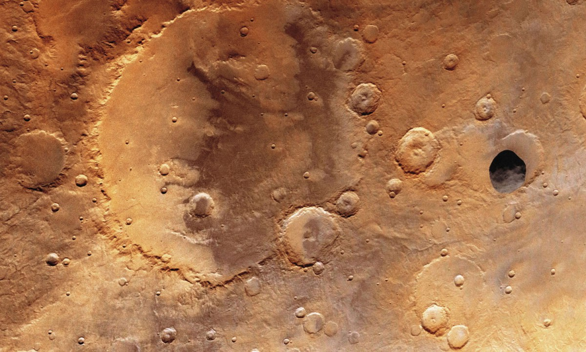 The larger of the two tiny Martian moons, Phobos